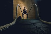 Fit woman with ropes