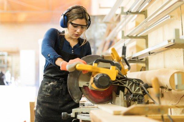 Female carpenter in workroom.