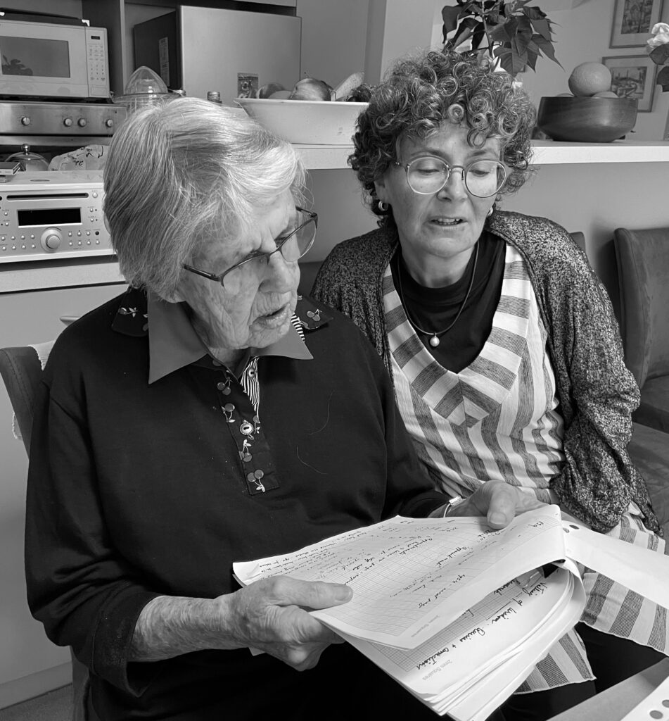 Joan Montgomery, left, with Kim Rubenstein as they review historical material for the book.